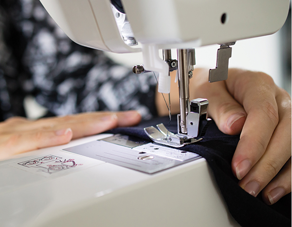 hands sewing at a machine
