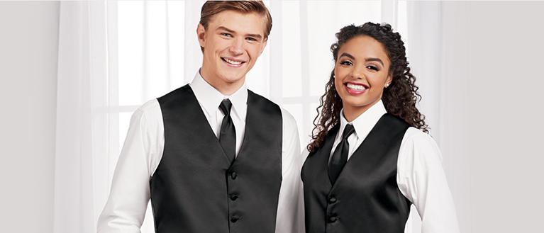 high school choir students in black vests