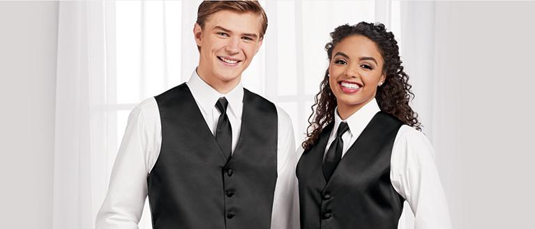 high school choir students in black vests